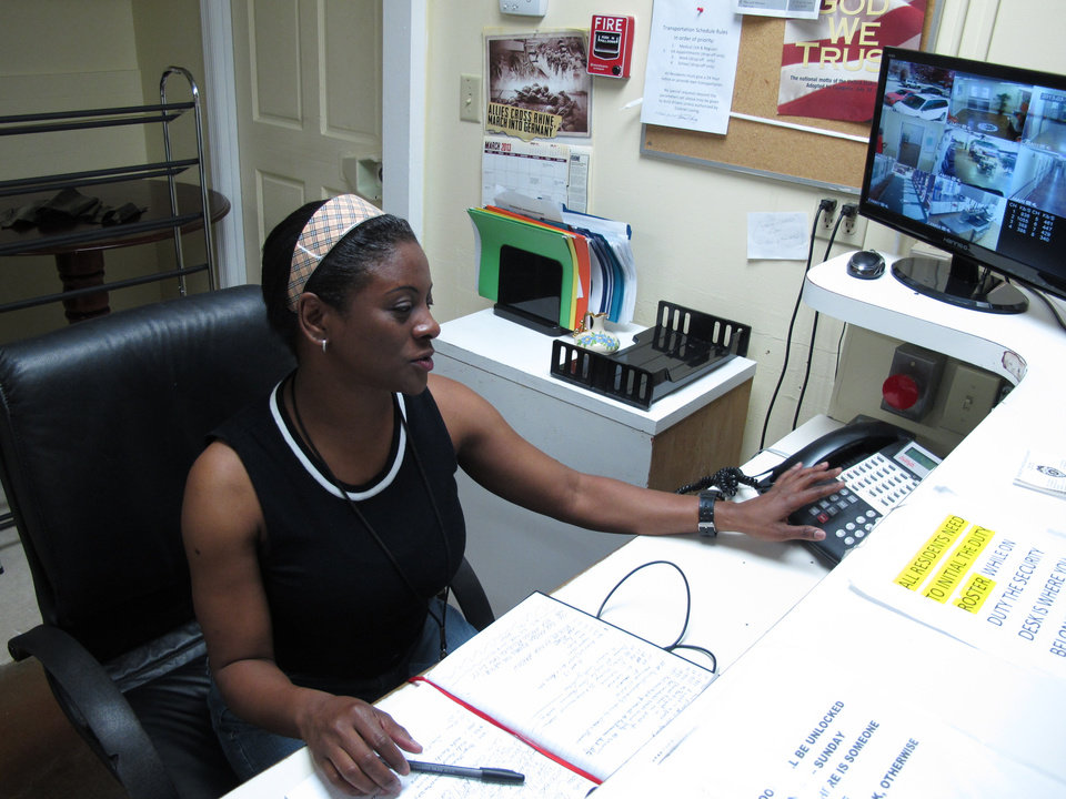 Photo - Debbie Bowman, who served 12 years in the Army, works the front desk at the Allied Veterans Center in Jacksonville, Fla., on Thursday, March 14, 2013. Bowman has been living at the shelter for homeless veterans since August. She says she lived in her car for a year before that. The center may be forced to shut down because its main source of funding was Allied Veterans of the World, which has had its leaders arrested and assets seized in an illegal gambling investigation. (AP Photo/Russ Bynum)