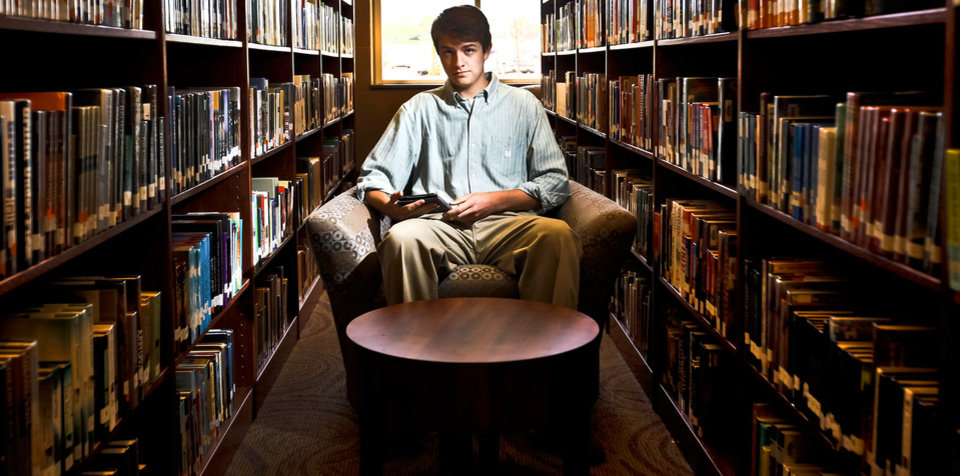 Photo - Yukon High School student Luke Swanson poses for a photo in the school's library with his self published civil war book 'Liberty and Justice For All' on Wednesday April 18, 2012, in Yukon, Oklahoma.  Photo by Chris Landsberger, The Oklahoman