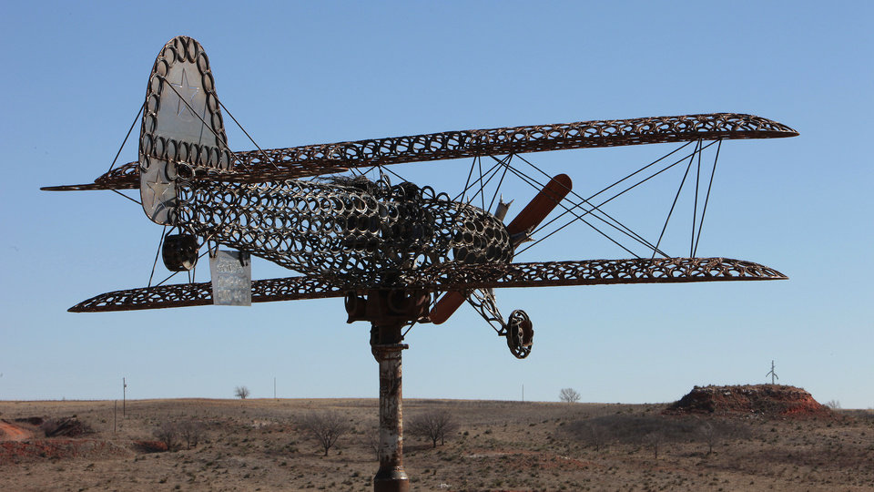 Shown is Joe Smith's biplane creation he made of horseshoes at his home near Leedey.  <strong>David McDaniel - The Oklahoman</strong>