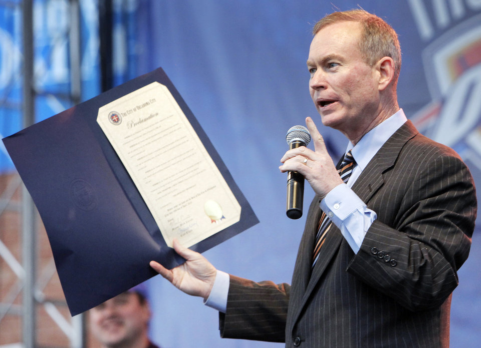 Photo - Oklahoma City Mayor Mick Cornett reads a proclamation during the Thunder FanFest in Bricktown, celebrating the team making it to the NBA playoffs, in Oklahoma City, Friday, April 16, 2010. Photo by Nate Billings, The Oklahoman