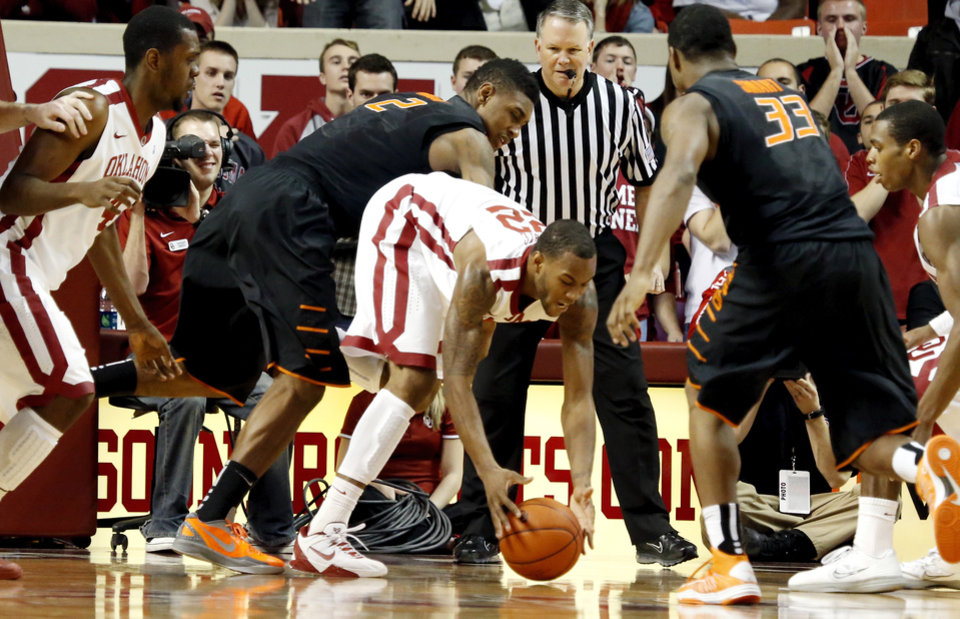 BEDLAM / OKLAHOMA STATE UNIVERSITY: Sooners\' Amath M\'Baye (22) gets a loose ball in front of Cowboys\' Le\'Bryan Nash (2) during the second half as the University of Oklahoma Sooners (OU) defeat the Oklahoma State Cowboys (OSU) 77-68 in NCAA, men\'s college basketball at The Lloyd Noble Center on Saturday, Jan. 12, 2013 in Norman, Okla. Photo by Steve Sisney, The Oklahoman