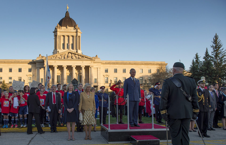 Photo - Prince Charles and his wife Camilla stand before the honour guard in front of the Manitoba Legislature Wednesday, May 21, 2014 in Winnipeg, Canada. (AP Photo/The Canadian Press,  Paul Chiasson)