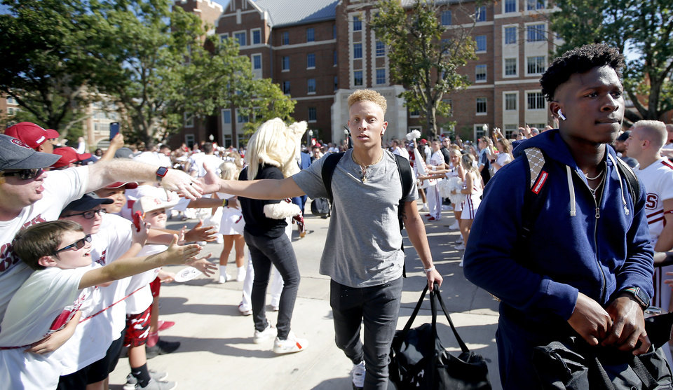 Photo - Oklahoma's Spencer Rattler (7) arrived before a college football game between the University of Oklahoma Sooners (OU) and the Houston Cougars at Gaylord Family-Oklahoma Memorial Stadium in Norman, Okla., Sunday, Sept. 1, 2019. [Sarah Phipps/The Oklahoman]