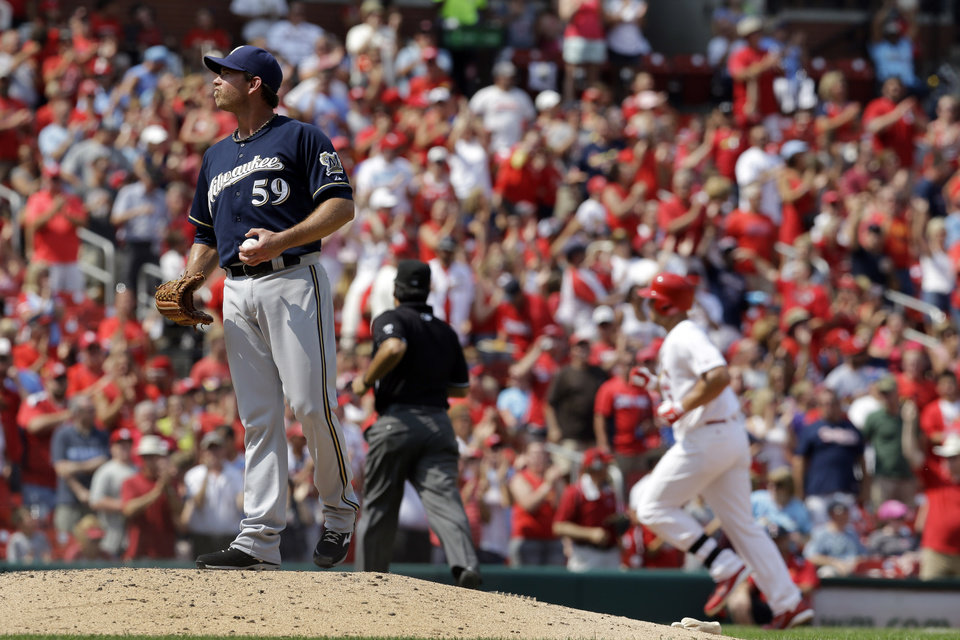Photo - St. Louis Cardinals' Matt Holliday, right, rounds the bases after hitting a solo home run off Milwaukee Brewers relief pitcher Zach Duke during the seventh inning of a baseball game Sunday, Aug. 3, 2014, in St. Louis. (AP Photo/Jeff Roberson)