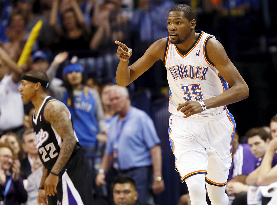 ALTERNATE CROP: Oklahoma City\'s Kevin Durant (35) reacts in front of Sacramento\'s Isaiah Thomas (22) after hitting a shot during an NBA basketball game between the Oklahoma City Thunder and the Sacramento Kings at Chesapeake Energy Arena in Oklahoma City, Monday, April 15, 2013. Oklahoma City won, 104-95. Photo by Nate Billings, The Oklahoman