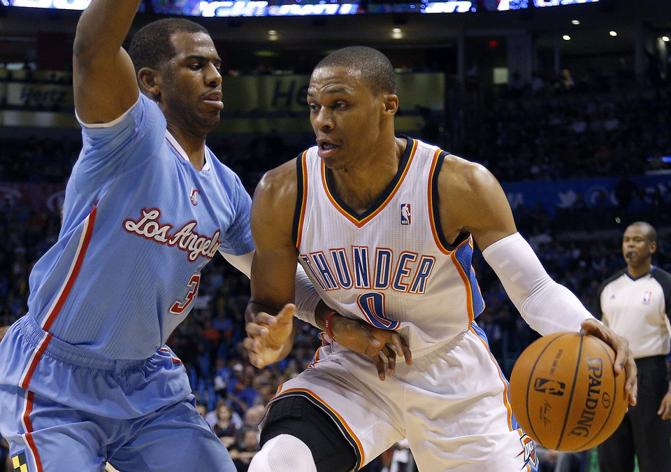 Photo - Oklahoma City 's Russell Westbrook (0) tries to drive past Los Angeles' Chris Paul (3) during the NBA game between the Oklahoma City Thunder and the Los  Angeles Clippers at the Chesapeake Energy Arena, Sunday, Feb. 23, 2014. Photo by Sarah Phipps, The Oklahoman