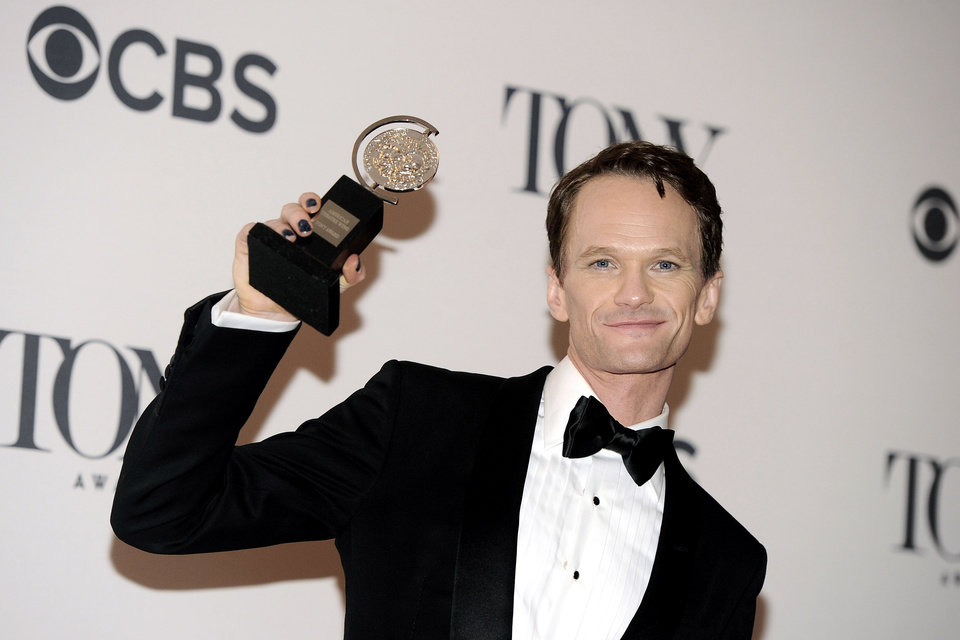 Photo - Neil Patrick Harris poses with his award for best performance by an actor in a leading role in a musical for his role in