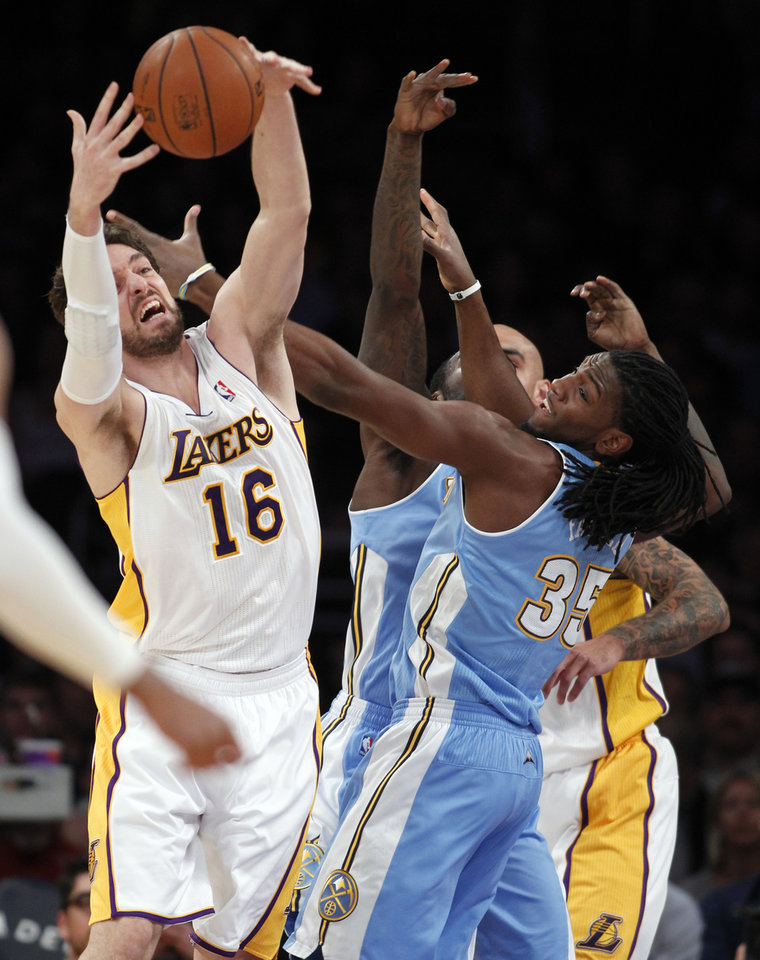 Los Angeles Lakers center Pau Gasol (16), of Spain, battles Denver Nuggets forward Kenneth Faried (35)  for the ball during the first half of an NBA basketball game, Sunday, Jan. 5, 2014, in Los Angeles. (AP Photo/Alex Gallardo)