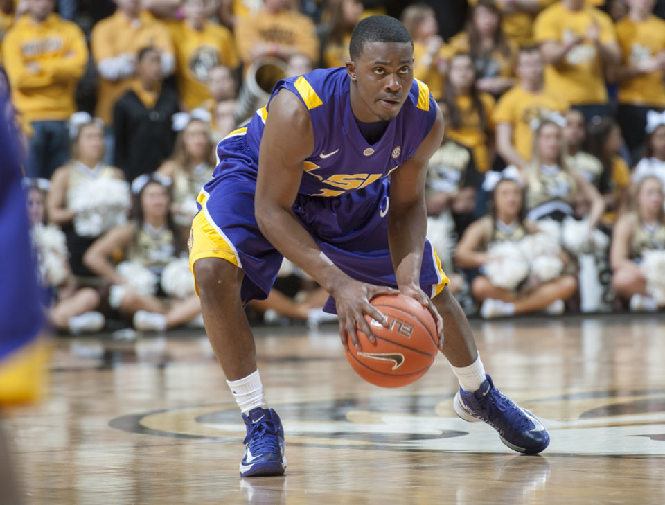 Photo - LSU's Anthony Hickey brings the ball up court during the second half of an NCAA college basketball game against Missouri Saturday, March 2, 2013, in Columbia, Mo. Missouri won the game 89-76. (AP Photo/L.G. Patterson)
