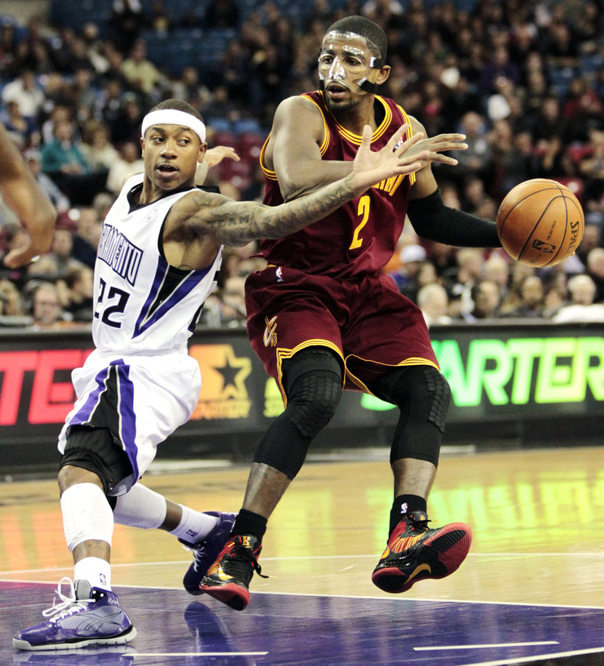 Photo - Sacramento Kings guard Isaiah Thomas, left, defends against Cleveland Cavaliers guard Kyrie Irving during the first quarter of an NBA basketball game in Sacramento, Calif., Monday, Jan. 14, 2013. (AP Photo/Rich Pedroncelli)