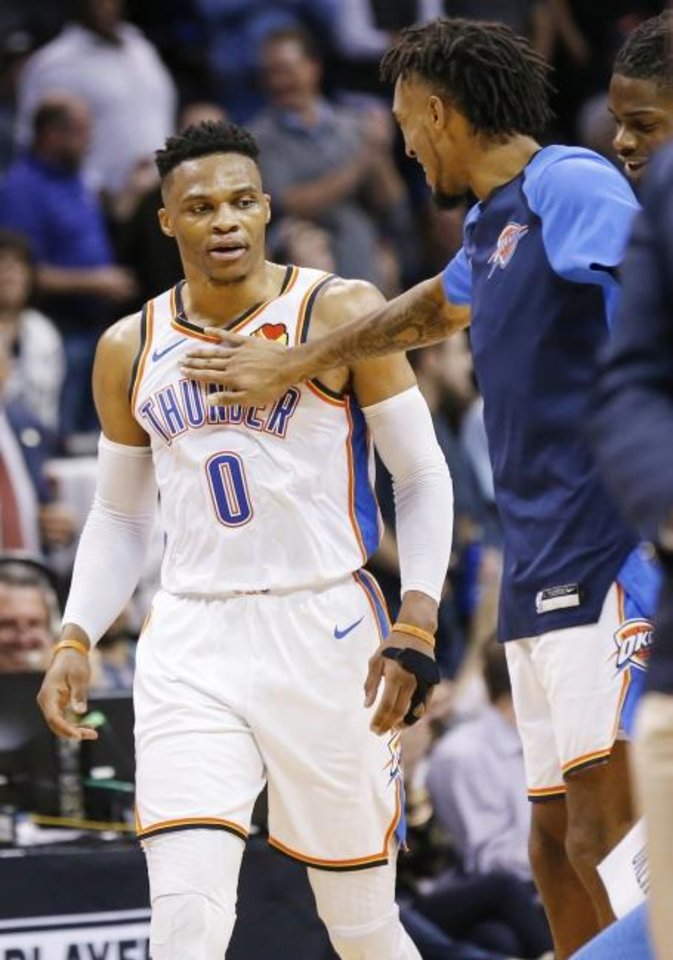 Photo -  Oklahoma City's Russell Westbrook (0) gets a slap on the chest from Terrance Ferguson (23) after Westbrook grabbed his last rebound in the fourth quarter to finish with 20 points, 20 rebounds and 21 assists on Tuesday night. [Nate Billings/The Oklahoman]
