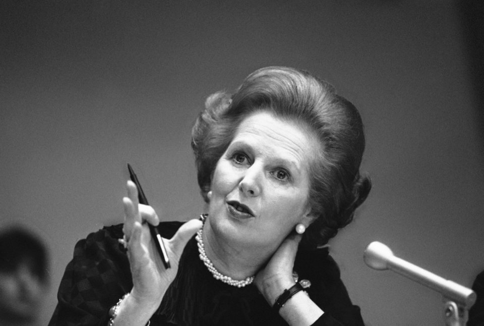 Photo - FILE - In this June 23, 1982 file photo, Britain's Prime Minister Margaret Thatcher gestures with her pen as she answers a reporters question during a news conference at the United Nations. Ex-spokesman Tim Bell says that Thatcher has died. She was 87. Bell said the woman known to friends and foes as