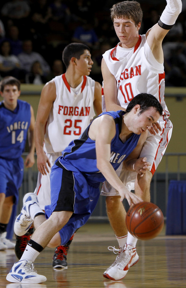 Photo - Lomega's Michael Risenhoover tries to get past Forgan's Jake Regier during the semifinal game of the Class B boys state basketball tournament at State Fair Arena in Oklahoma CIty, Friday, March 3, 2012. Photo by Bryan Terry, The Oklahoman