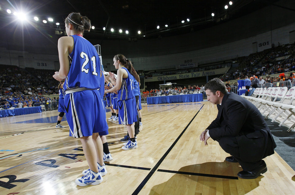 Photo - Lomega coach Kevin Lewallen kneels behind his team after the Class B girls state championship high school basketball game between Hammon and Lomega at State Fair Arena in Oklahoma City, Saturday, March 3, 2012. Lomega won, 49-44. Photo by Nate Billings, The Oklahoman