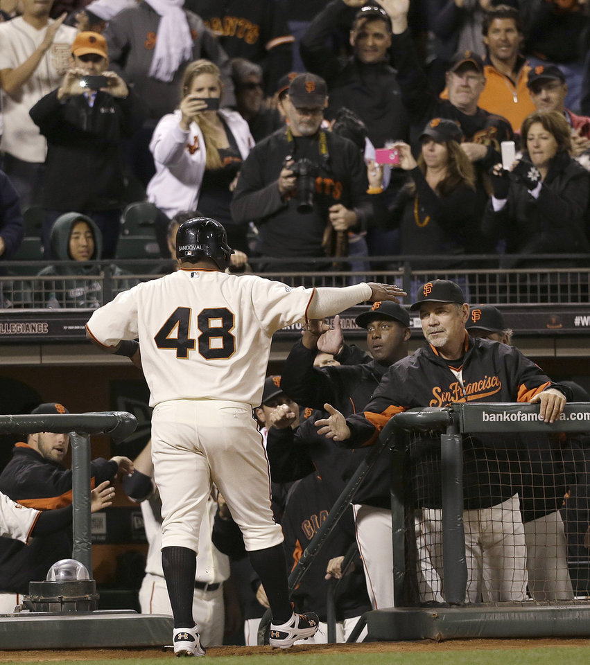 Photo - San Francisco Giants' Pablo Sandoval (48) is congratulated by manager Bruce Bochy, right, after scoring on Tony Abreu's three-run triple against the Los Angeles Dodgers during the second inning of a baseball game in San Francisco, Wednesday, Sept. 25, 2013. (AP Photo/Jeff Chiu)