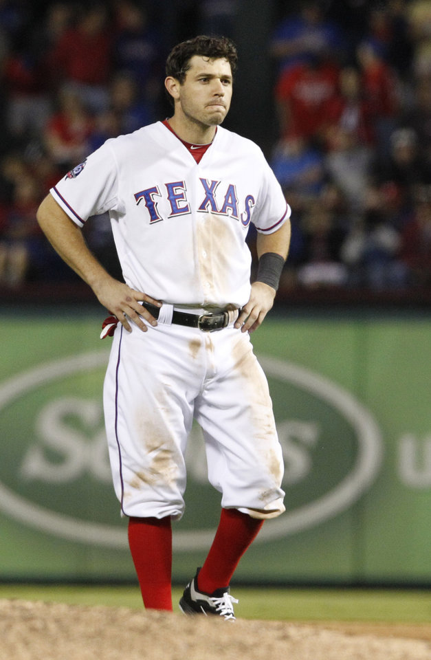 Texas Rangers Ian Kinsler stands on the field after the final out of the eighth inning against the Baltimore Orioles in the American League wild-card playoff baseball game Friday, Oct. 5, 2012 in Arlington, Texas. The Orioles won 5-1. (AP Photo/LM Otero)