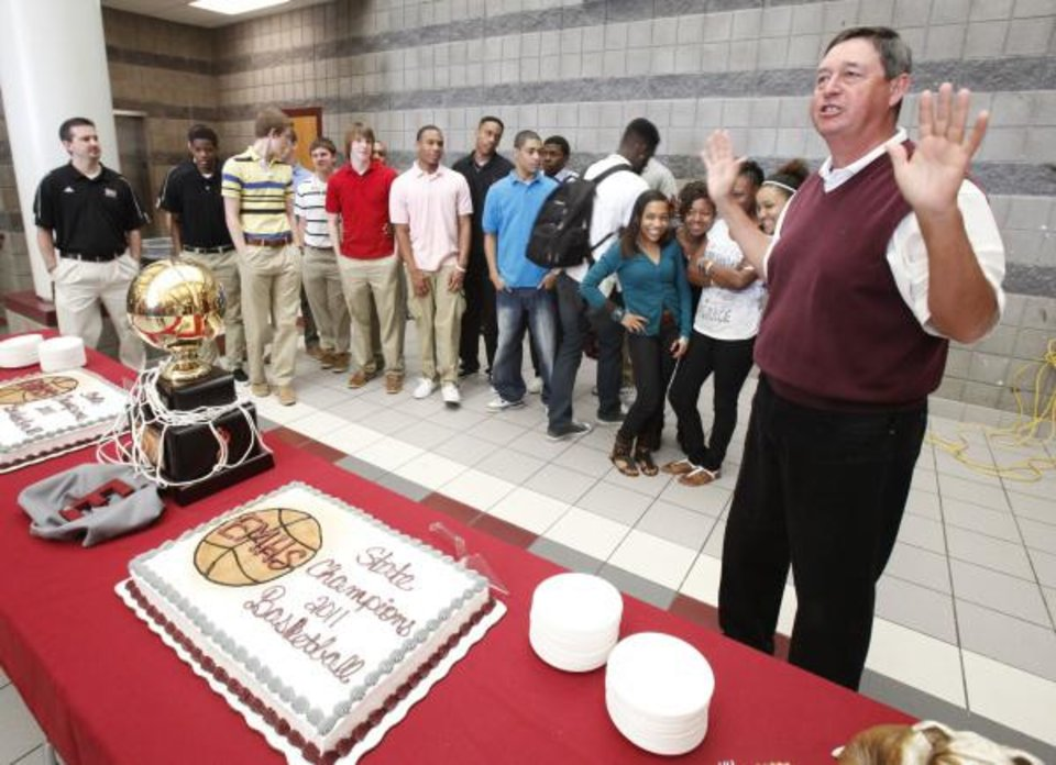 Athletic Director Mike DeLagarza speaks as the Edmond Memorial boys basketball team celebrates their State Championship during a ceremony at Edmond Memorial High School in Edmond, OK, Friday, March 25, 2011. By Paul Hellstern, The Oklahoman <strong>PAUL HELLSTERN</strong>