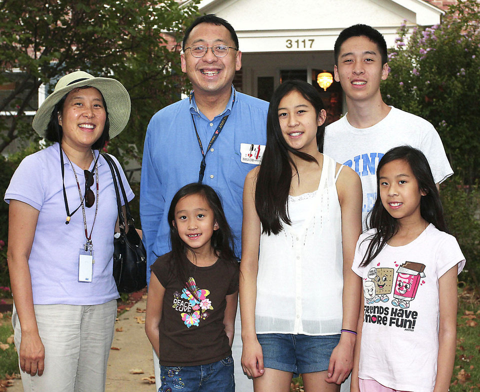 Judy, Frank, Olivia, 7, Emily, 13, Christopher, 15,  Waverly, 11, Wang.