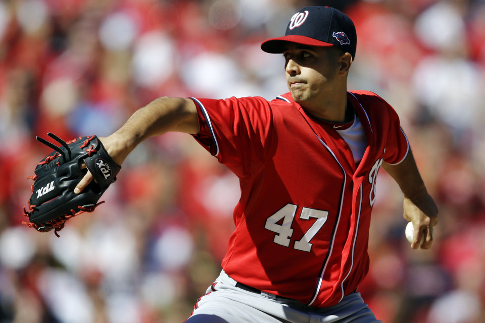 Washington Nationals starting pitcher Gio Gonzalez throws during the first inning in Game 1 of baseball's National League division series against the St. Louis Cardinals, Sunday, Oct. 7, 2012, in St. Louis. (AP Photo/Jeff Roberson)