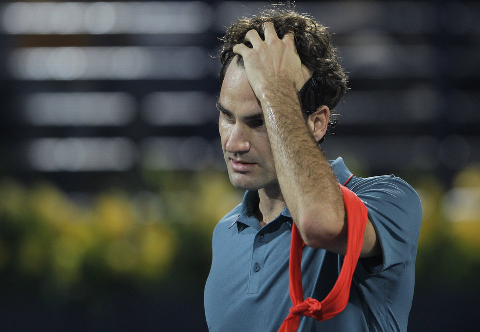 Photo - Roger Federer of Switzerland reacts after he beat Radek Stepanek of Czech Republic during the third day of the Dubai Duty Free Tennis Championships in Dubai, United Arab Emirates, Wednesday, Feb. 26, 2014. (AP Photo/Kamran Jebreili)