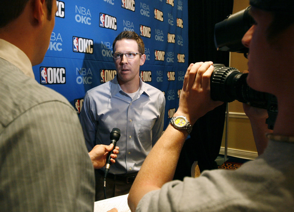 Photo - OKC NBA, FORMER SEATTLE SUPERSONICS, SONICS BASKETBALL TEAM: Sam Presti, general manager of the Oklahoma City NBA franchise, gives a television interview after a press conference at the Skirvin Hilton Hotel in Oklahoma City, Thursday, July 10, 2008. BY NATE BILLINGS, THE OKLAHOMAN ORG XMIT: KOD