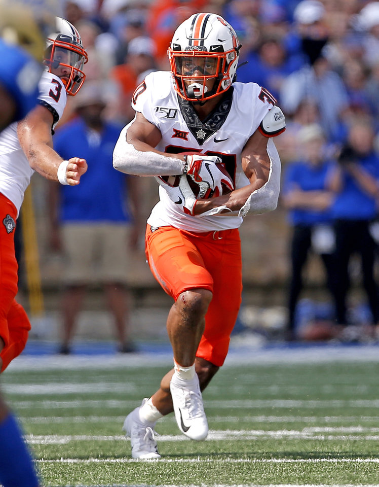 Photo - Oklahoma State's Chuba Hubbard (30) rushes in the second first quarter during a college football game between the Oklahoma State University Cowboys (OSU) and the University of Tulsa Golden Hurricane (TU) at H.A. Chapman Stadium in Tulsa, Okla., Saturday, Sept. 14, 2019. [Sarah Phipps/The Oklahoman]