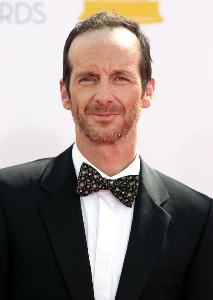 Photo -   Denis O'Hare arrives at the 64th Primetime Emmy Awards at the Nokia Theatre on Sunday, Sept. 23, 2012, in Los Angeles. (Photo by Matt Sayles/Invision/AP)