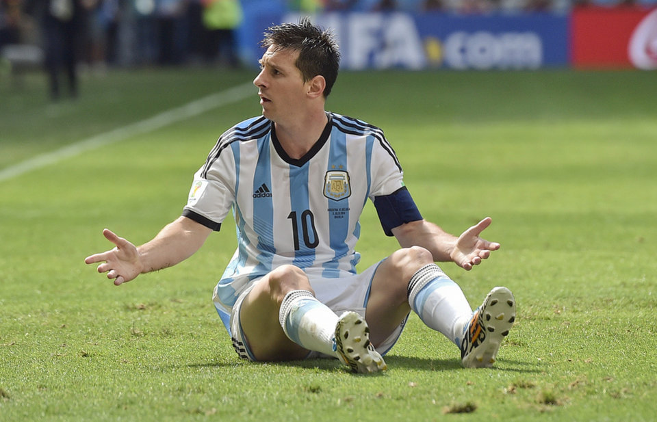 Photo - Argentina's Lionel Messi appeals for a foul during the World Cup quarterfinal soccer match between Argentina and Belgium at the Estadio Nacional in Brasilia, Brazil, Saturday, July 5, 2014. (AP Photo/Martin Meissner)