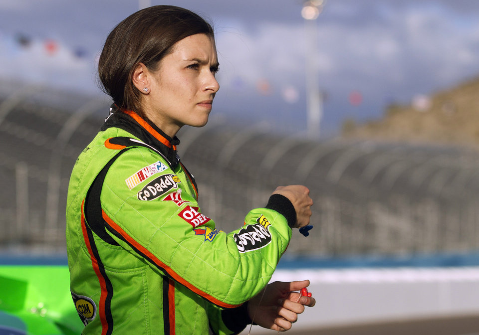 Photo -   Danica Patrick reacts as she looks at a scoreboard displaying her time during qualifying for the NASCAR Sprint Cup Series auto race, Friday, Nov. 9, 2012, at Phoenix International Raceway in Avondale, Ariz. (AP Photo/Paul Connors)