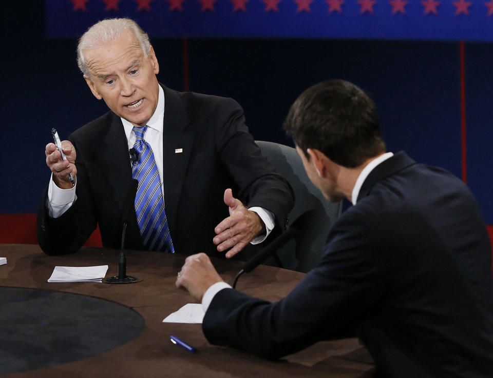 FILE - This Oct. 11, 2012 file photo shows Vice President Joe Biden, left, and Republican vice presidential nominee Rep. Paul Ryan of Wisconsin participating in the vice presidential debate at Centre College in Danville, Ky. Biden tangled with Ryan in a televised debate and responded to Ryan\'s comments about foreign policy,
