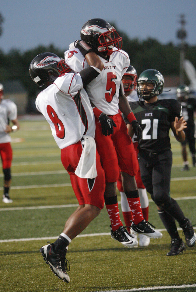Photo - Del City's Greg Johnson (5) celebrates a touchdown pass with teammate Marquis Walters (8) in first half action against Norman North in high school football at Harve Collins Field on Thursday, Sept. 9, 2010, in Norman, Okla.  Photo by Steve Sisney, The Oklahoman