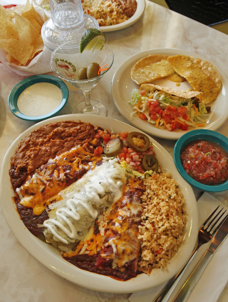 Photo - The Elvis Presley Memorial Combo has beef, tomatillo and chicken enchiladas; ground sirloin crispy taco, and tostada chips dipped in chile con queso at the new Chuy's Mexican restaurant in Norman.  STEVE SISNEY - THE OKLAHOMAN