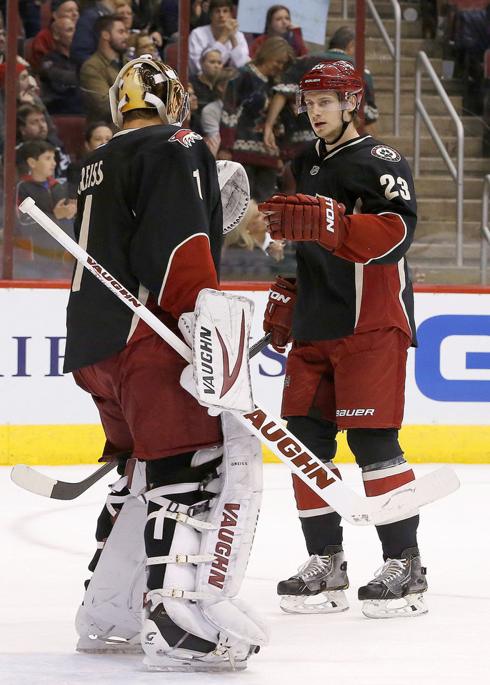 Photo - Phoenix Coyotes' Oliver Ekman-Larsson (23), of Sweden, gets a high-five from goalie Thomas Greiss (1), of Germany, after his goal against the Los Angeles Kings during the first period of an NHL hockey game, Tuesday, Jan. 28, 2014, in Glendale, Ariz. The Coyotes defeated the Kings 3-0. (AP Photo/Ross D. Franklin)