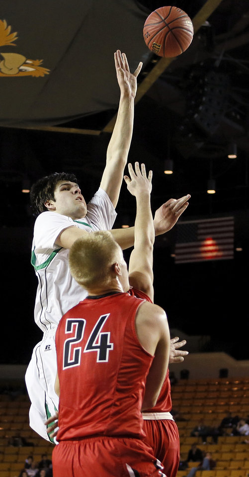 Photo - Will Lienhard (33) shoots for Bishop McGuinness against Matt Craig (24) of Bishop Kelley during a Class 5A boys semifinal game in the state basketball championship tournament between Bishop McGuinness and Bishop Kelley at the Mabee Center in Tulsa, Okla., Friday, March 14, 2014. Photo by Nate Billings, The Oklahoman