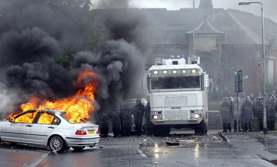 Photo -   A car burns after Nationalist rioters clashed with Police Service of Ireland in the Ardoyne area of North Belfast, Northen Ireland, Thursday, July 12, 2012. Trouble broke out after an Orange Order march passed the area. The Twelfth of July is the busiest day of the marching season in Northern Ireland with thousands of Orangemen and women, accompanied by marching bands, taking part in hundreds of parades. The Orange Order holds its main Belfast event, which commemorates King William III's 1690 Battle of the Boyne victory over Catholic King James II. (AP Photo/Peter Morrison)
