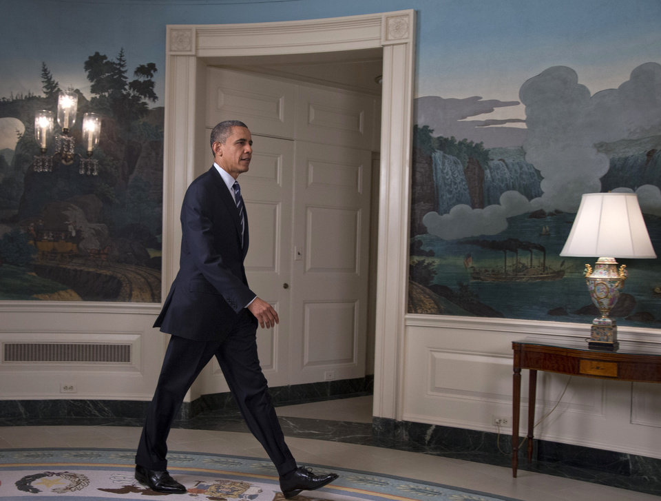 Photo -   President Barack Obama arrives in the Diplomatic Room of the White House in Washington, Tuesday, Aug. 28, 2012, to talk about Tropical Storm Isaac. (AP Photo/Carolyn Kaster)