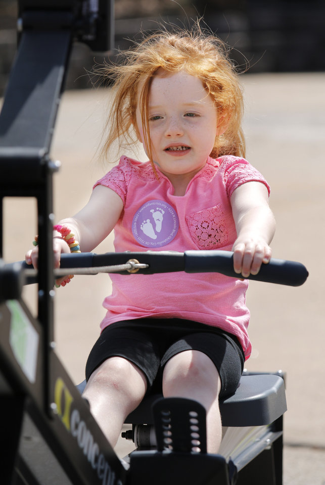 Photo - Charlotte Greenhow, 4, tries out the rowing machines  at Open Streets OKC, along NW 23rd Street between Robinson and Western, Sunday, March 22, 2015. Photo by Doug Hoke, The Oklahoman