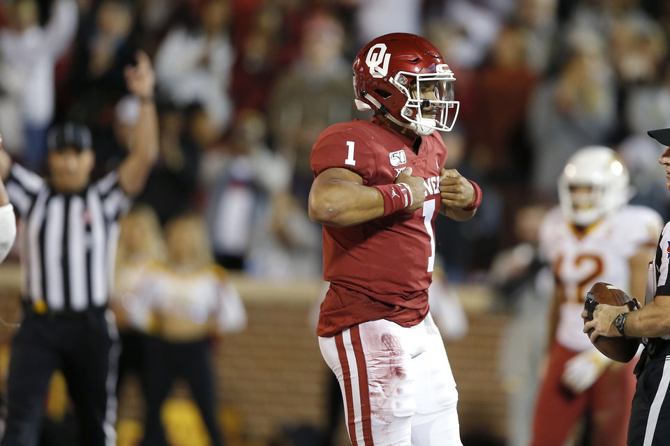 Photo - Oklahoma's Jalen Hurts (1) celebrates after scoring a touchdown during an NCAA football game between the University of Oklahoma Sooners (OU) and the Iowa State University Cyclones at Gaylord Family-Oklahoma Memorial Stadium in Norman, Okla., Saturday, Nov. 9, 2019. [Bryan Terry/The Oklahoman]