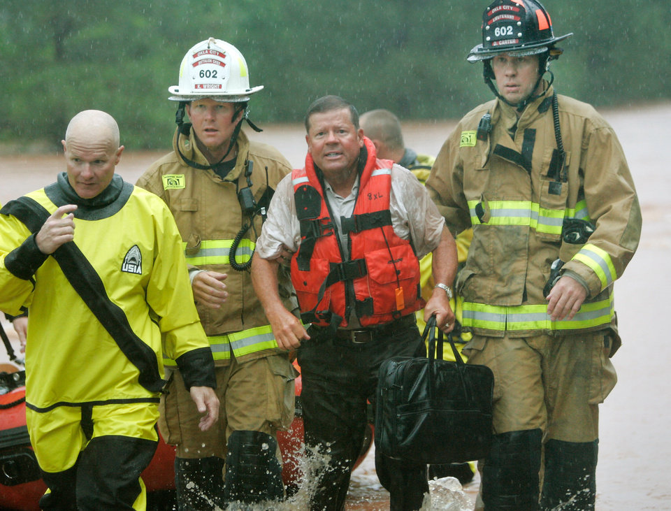 Oklahoma City firefighters rescued stranded motorist Dr. Randy Robinson from a bridge near Hefner Road and Sooner in Oklahoma City during flooding on June 14 , 2010. Photo by Steve Gooch, The Oklahoman