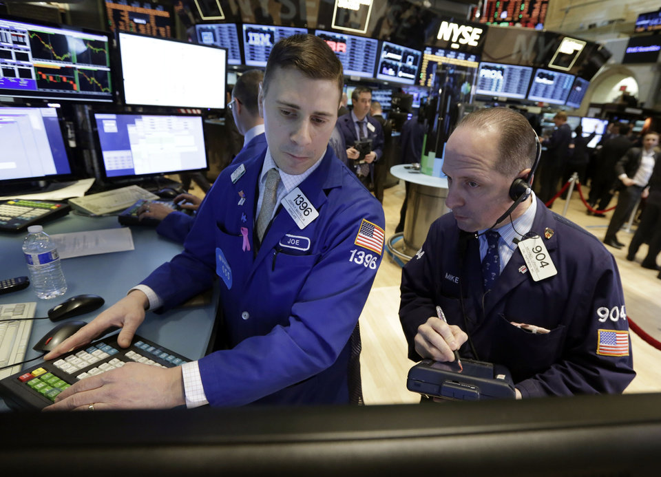 Photo - Specialist Joseph Mastrolia, left, and trader Michael Urkonis work on the floor of the New York Stock Exchange, Tuesday, March 25, 2014.  Stocks are opening higher on Wall Street as the market shrugs off a two-day decline. (AP Photo/Richard Drew)