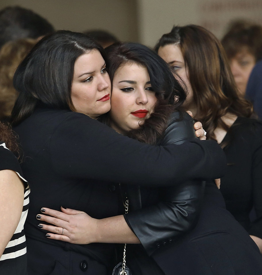 Ana Sabrina Carmona, right, is hugged by her sister after the casket carrying the body of her fianc�©, Rex Schad, is taken from the church and placed into a hearse. Celebration of Life service  for US Army SSgt. Rex L. Schad at LifeChurch.tv in Edmond Thursday afternoon,  March 21, 2013.  Schad was killed earlier this month while conducting a patrol brief with the Afghanistan National Police.  He is a 2005 graduate of Edmond Memorial High School.    Photo by Jim Beckel, The Oklahoman