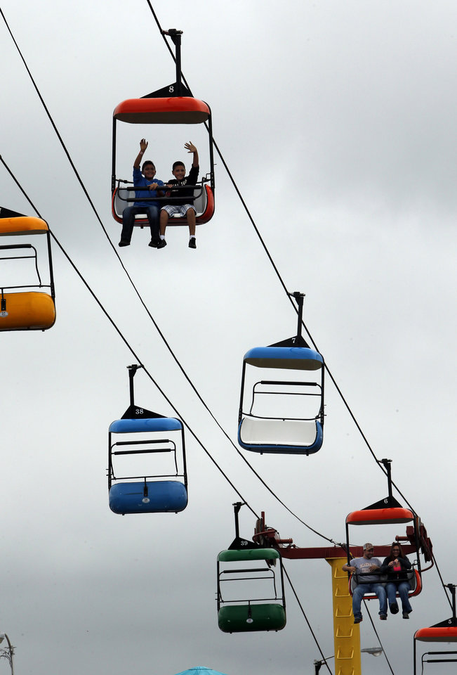 Photo - Fairgoers ride the cable cars at the 106th Oklahoma State Fair at State Fair Park on Saturday, Sept. 15, 2012, in Oklahoma City, Okla.  Photo by Steve Sisney, The Oklahoman