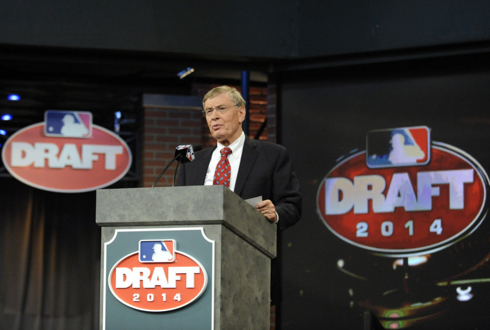 Photo - Baseball Commissioner Bud Selig announces the selections during the baseball draft Thursday, June 5, 2014, in Secaucus, N.J. (AP Photo/Bill Kostroun)