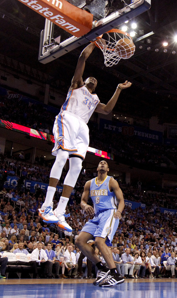 Oklahoma City's Kevin Durant (35) dunks the ball in front of Denver's Arron Afflalo (6) during the NBA basketball game between the Oklahoma City Thunder and the Denver Nuggets at Chesapeake Energy Arena in Oklahoma City, Wednesday, April 25, 2012. Photo by Bryan Terry, The Oklahoman