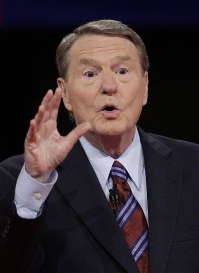 FILE - In a Sept. 26, 2008 file photo, moderator Jim Lehrer discusses the rules of the debate with the audience prior to the start of the presidential debate, at the University of Mississippi in Oxford, Miss. Lehrer said Thursday, May 12, 2011 that he is retiring as a regular anchor of PBS\'