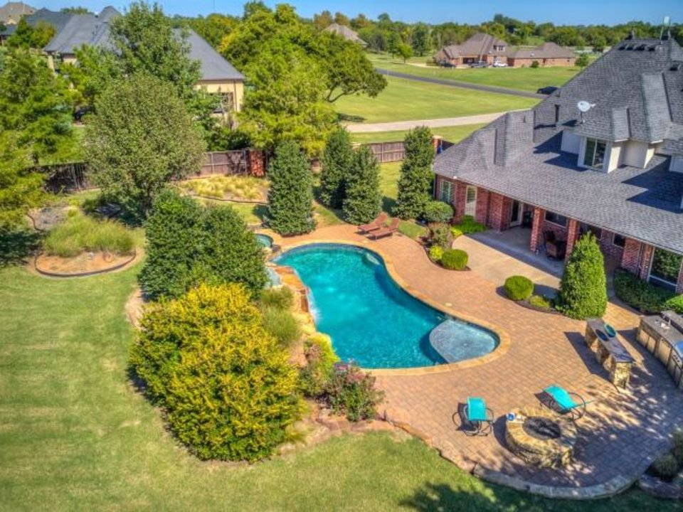 Photo -  Back of 18011 Carlton Drive, Edmond, the Listing of the Week. [PHOTO PROVIDED]