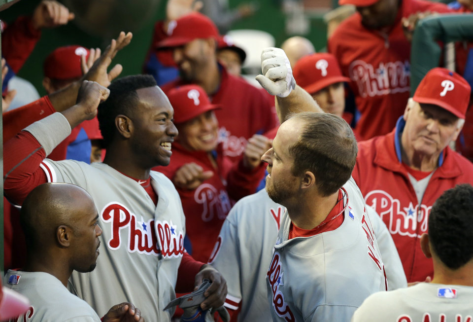 Philadelphia Phillies' Domonic Brown, left, and Erik Kratz celebrate after their back to back solo home runs during the second inning of a baseball game against the Washington Nationals at Nationals Park, Saturday, May 25, 2013, in Washington. (AP Photo/Alex Brandon)