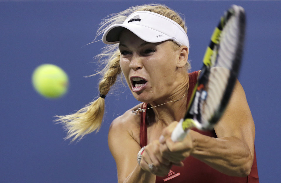 Photo - Caroline Wozniacki, of Denmark, returns to Sara Errani, of Italy, during the quarterfinal round of the 2014 U.S. Open tennis tournament, Tuesday, Sept. 2, 2014, in New York. (AP Photo/Charles Krupa)