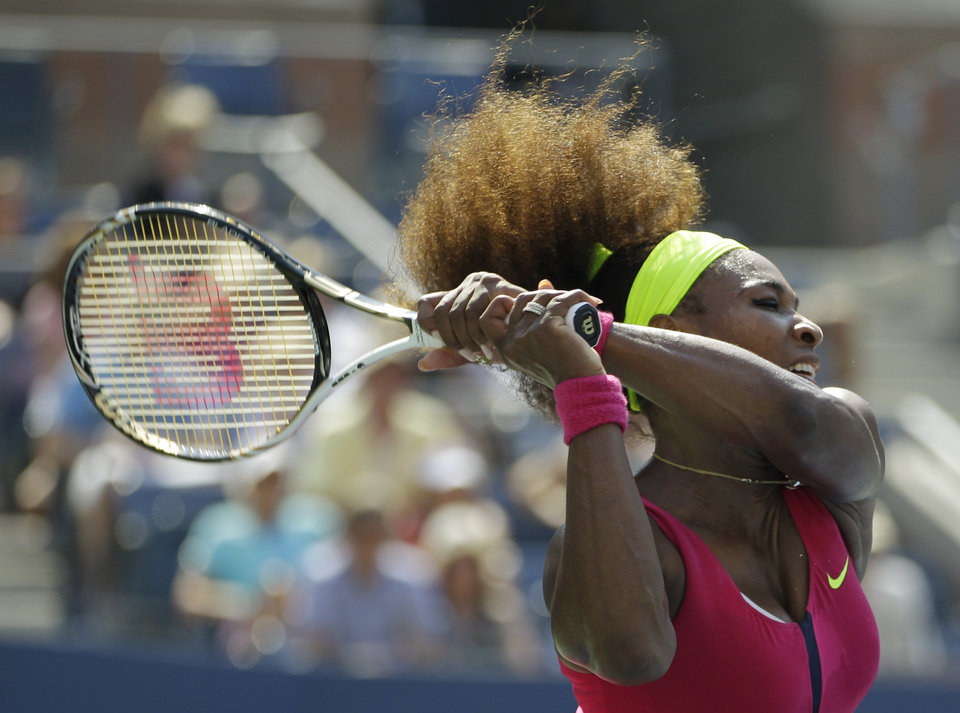 Photo -   Serena Williams returns a shot to Russia's Ekaterina Makarova in the third round of play at the 2012 US Open tennis tournament, Saturday, Sept. 1, 2012, in New York. (AP Photo/Kathy Willens)