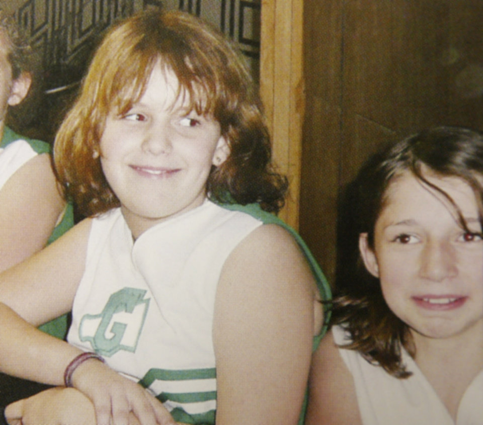 Photo - MURDERS, SHOOTING DEATHS, GIRLS, WELEETKA, TAYLOR PLACKER, TAYLOR PASCHAL-PLACKER, SKYLA WHITAKER: Copy of photo of Taylor Dawn Paschal-Placker and Skyla Jade Whitaker in their cheerleader outfits, Monday, June 9, 2008.  Photo provided by Graham Schools.  ORG XMIT: kod